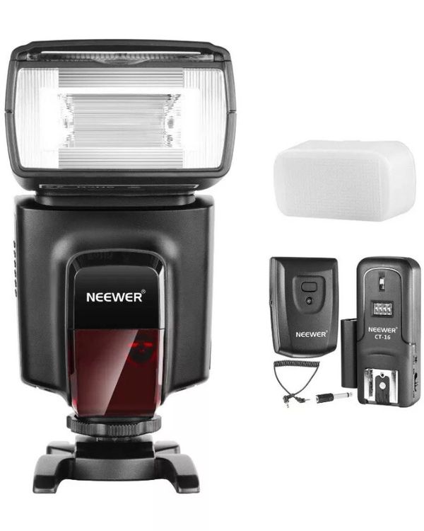 2x Universal Speedlight with trigger and 2x receiver. Diffuser and a Shoe mount for flash stand