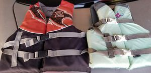 Boy and girl life jackets. for Sale in Phoenix, AZ
