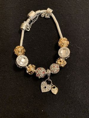 Silver with gold color charm bracelet for Sale in Kent, WA