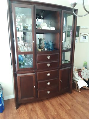Dining room Hutch and display cabinet with glass shelving and Lighting oh, good condition and great quality for Sale in Port St. Lucie, FL