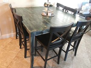 Real wood table. Seats six. Can convert to a smaller size with adjustable middle. Normal wear. for Sale in Boca Raton, FL