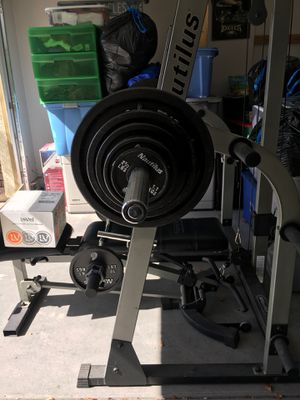 Olympic weight bench, lat pull down, straight bar curl, 210 pounds in weight. for Sale in Las Vegas, NV