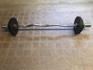 Olympic curl bar with weights for Sale in Deerfield, IL