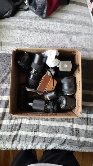 Box full of random SLR camera lenses. Included is a Ricoh 35 with leather case for Sale in Newport Beach, CA