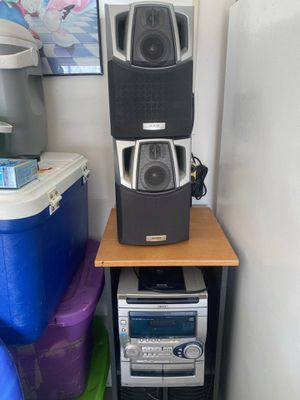 Stereo system along with center holder and storage system for Sale in Poinciana, FL