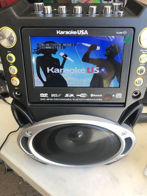 "Karaoke USA GF844 Complete Karaoke System with 2 Microphones, Remote Control, 7"" Color Screen, LED Lights - Works with DVD, Bluetooth, CD, MP3 and Al for Sale in Las Vegas, NV"