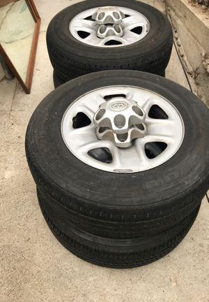 Set of 4 tires rims Bridgestone dueler 255/70/R18 for Sale in Inglewood, CA