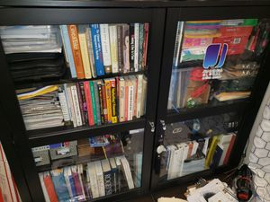 Black 8-shelving unit with glass doors for Sale in Washington, DC