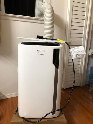 DeLonghi Pinguino 4-in-1 portable Air Conditioner,heater,dehumidifier and Fan + remote control used 2 months only like new. With all accessories. for Sale in Fremont, CA