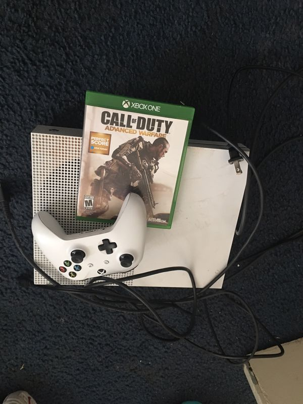 White Xbox 1s with games on it and come with 1 game 1 controller