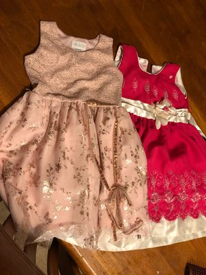 NOT FREE. Girls dresses take both for $5.00 firm for Sale in Los Angeles, CA