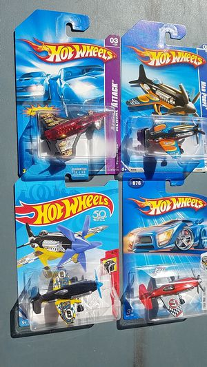 Hot Wheels set of four mad props planes for Sale in Oceanside, CA
