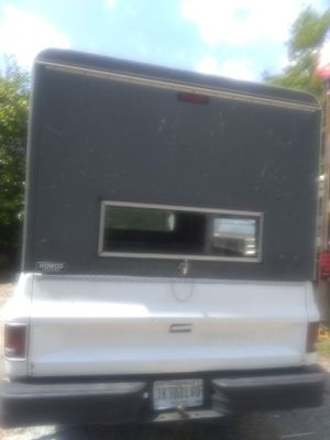 Tall camper shell fits 8 foot bed no leaks shocks on door works perfect 150 firm for Sale in Lawrence, IN