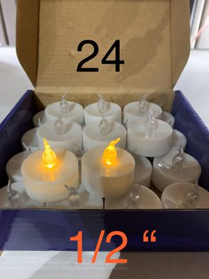 24 new warm white/yellow tea candles for Sale in Riverside, CA
