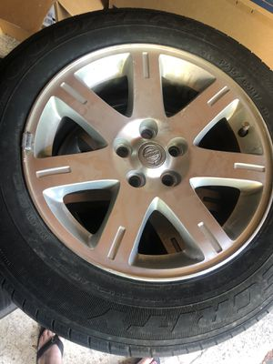 """Set of four used Goodyear tires with stock Chrysler 300 alloy rims 17"""" for Sale in Vancouver, WA"""