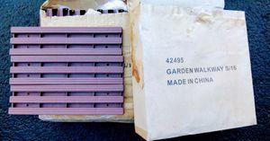 2 cases brown garden walkway slats for Sale in Medford, OR