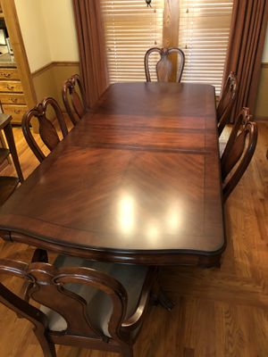 Beautiful Cherry dining table 6 chairs including two arm chairs and a custom fitted heat protector. China cabinet and side table. All furniture has for Sale in Columbus, OH