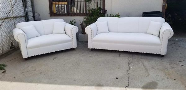 NEW WHITE LEATHER COUCHES