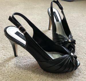 Black leather heels platform heels size 8 for Sale in Tustin, CA