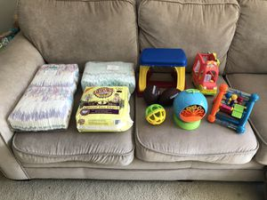 Diapers and toys for Sale in Laurel, MD
