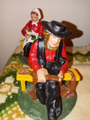 vintage cast iron Amish couple bookends or door stoppers for Sale in Martinsburg, WV