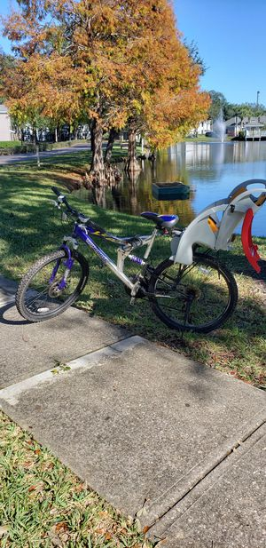 Mountain bicicle whit baby seat for Sale in Kissimmee, FL