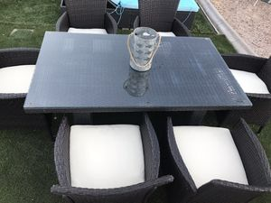 Patio wicker furniture 6 chairs with cushions and table with glass on top for Sale in North Las Vegas, NV