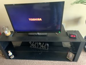 32in flat screen /Black, glass shelve TV stand for Sale in Indianapolis, IN