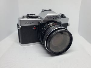 1980s Minolta XG-A 35mm film camera w/ 28mm 1:2.8 lens for Sale in Tustin, CA