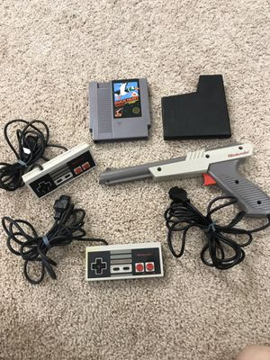 Vintage Nintendo NES controllers,Zapper and Duck Hunt Game for Sale in Rockville, MD