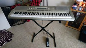 Casio WK-200 76-Key Personal Keyboard Package with Stand and Pedal-$150(HOUSTON) for Sale in Houston, TX