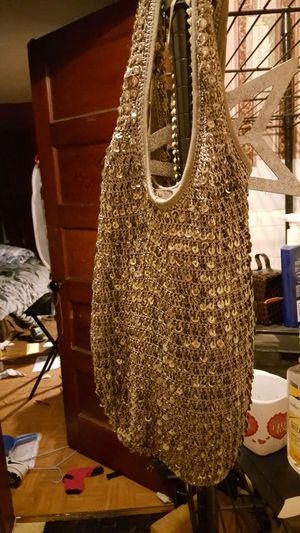 OLDER BUT ONLY USED ONCE BLING PPURS FROM MACYS for Sale in Canton, MA