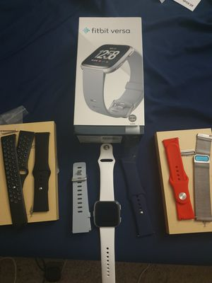 Open box Fitbit Versa with 7 bands. for Sale in Bellevue, WA