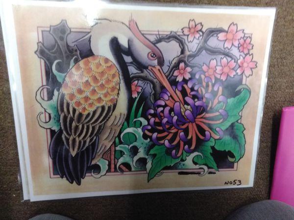 Artwork from tattoo shop display wall
