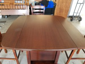 All wood drop leaf table with chairs for Sale in Selma, CA