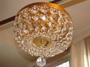 H5xW12 Swarovski Crystals on gold plated structure flush mount chandelier for Sale in Chandler, AZ