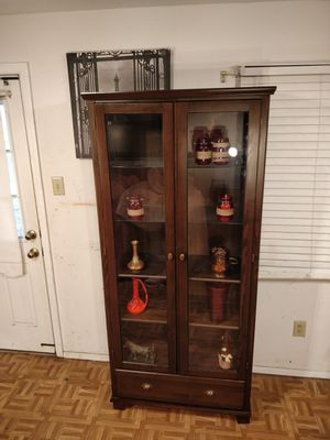 Like new wooden cabinet with wood& glass shelves,one big drawer in great condition, let me know when can for Sale in Annandale, VA