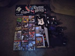 Playstation 2 slim Ps2 Guitar Hero Black Wired Controller Sg SA with 15 games 3 controllers and headphones $125 for Sale in Sicklerville, NJ