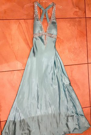 Turquoise formal prom dress- Hailey Logan by Adrianna papell. Sizes 9/10 but it fits like a small.Color is more like the close up photos for Sale in El Paso, TX