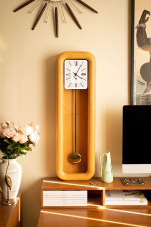 Howard Miller Long Oak Pendulum Wall Clock Oak Mid Century Modern | Model 622237 for Sale in Peoria, AZ