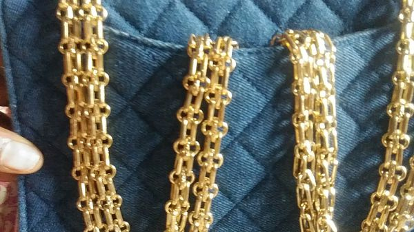 Blue jean bag with a heavy gold change $20