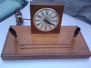Antique desktop wooden clock with decorative inlay and writing instrument holders for Sale in Gahanna, OH