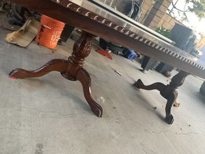 Beautiful wooden table very heavy and sturdy Just some scratches here and there but no cracks or broken. Very heavy and Needs at least four people t for Sale in Fontana, CA