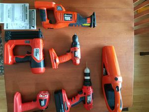 black & decker drill with dual chuck, vacuum, light, reciprocating saw, and another drill, 18 volt set, includes charger and one battery. for Sale in Bartlett, TN