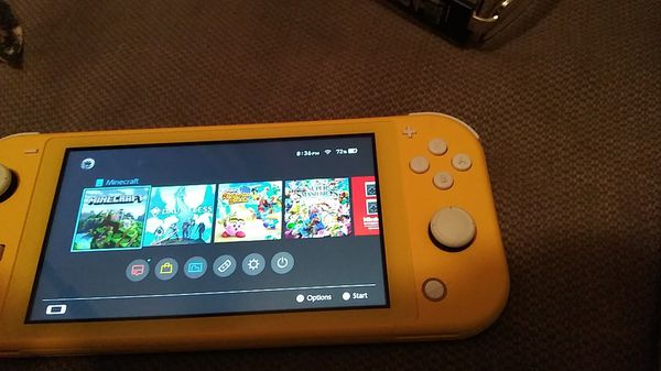 Nintendo switch with a 128gb card and a bunch of games including mine craft and super smash