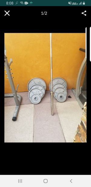 Weight Plates with olympic bar for Sale in Baldwin Park, CA