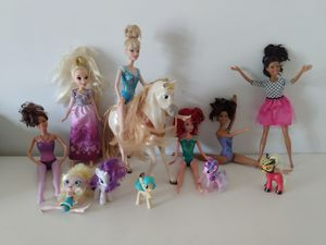 12 toys. 6 barbie dolls and a horse +4 my little poney + free girl doll. Return accepted if not 100% satisfied! for Sale in Kissimmee, FL