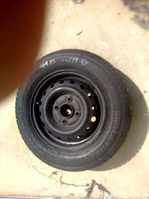 New Honda tire 185 /70 R 14 aired up on 4 lug rim for Sale in Sacramento, CA