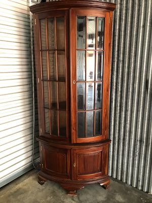 "Corner wood cabinet 4 shelves top and storage on bottom with key Glass panels curved look 78.75"" h for Sale in Longwood, FL"