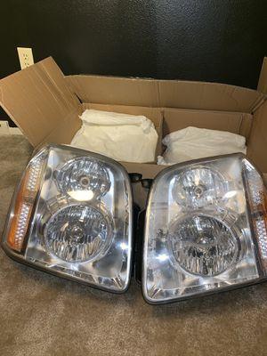 07-14 Yukon Headlights for Sale in Holland, MI